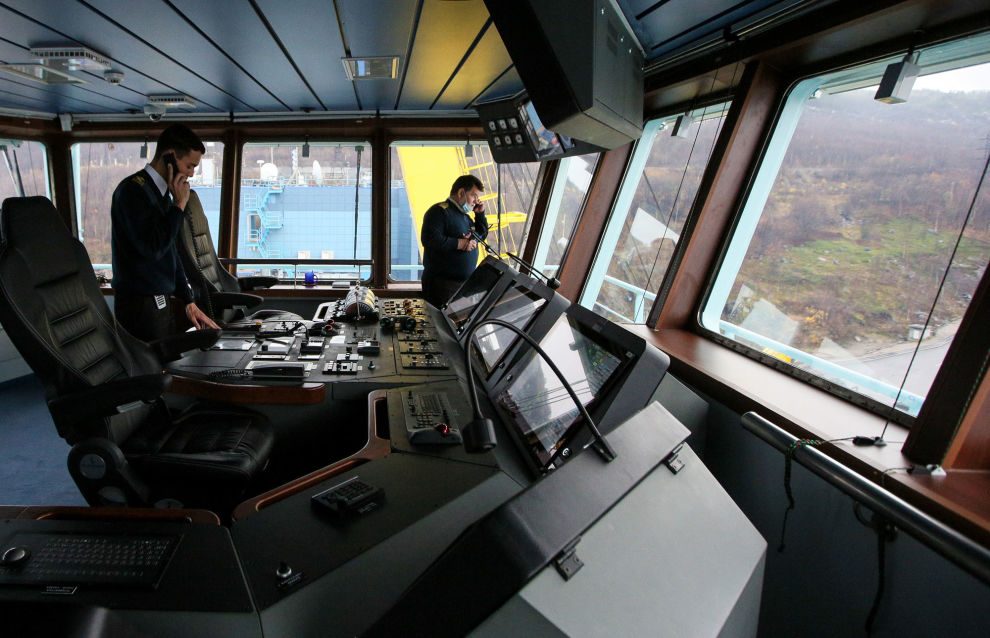 Crew members are pictured at the wheelhouse of Russian Arktika nuclear-powered icebreaker, in Murmansk, Russia. The ice-breaker left St. Petersburg on September 22 and made a 21 day journey of 4,800 nautical miles