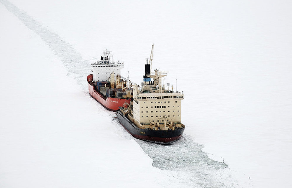 The Taimyr icebreaker leads the Yury Arshenevsky lighter carrier ship along the Yenisei