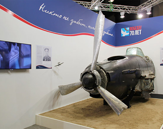 An exhibition was organized in the forum's hall, including the body of a fighter aircraft shot down during the Great Patriotic War