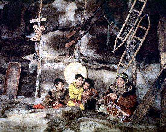 A Koryak family inside a traditional Yaranga wigwam