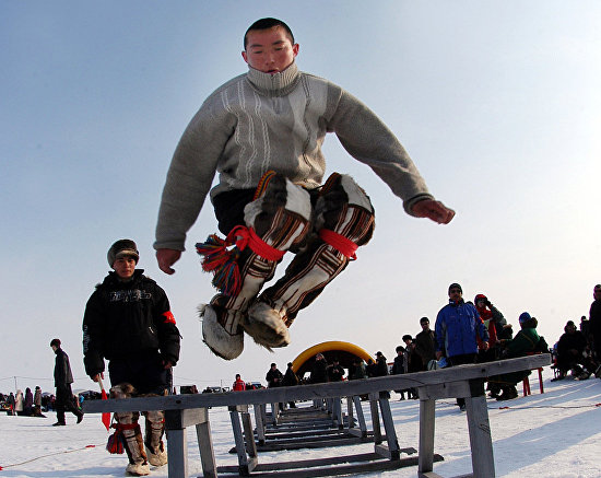 Jumping over dog sleds