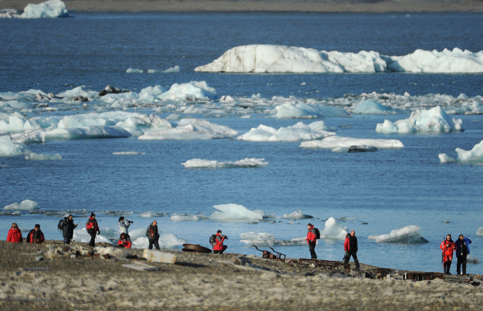 Russian Arctic National Park staff study artifacts of a German weather station