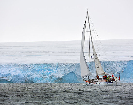 The Alter Ego, expedition yacht, traverses the glacier from Cape Fligely to Cape Wellman, Rudolf Island
