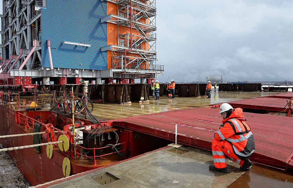 Workers at the construction site of the Yamal LNG plant and the Sabetta sea port