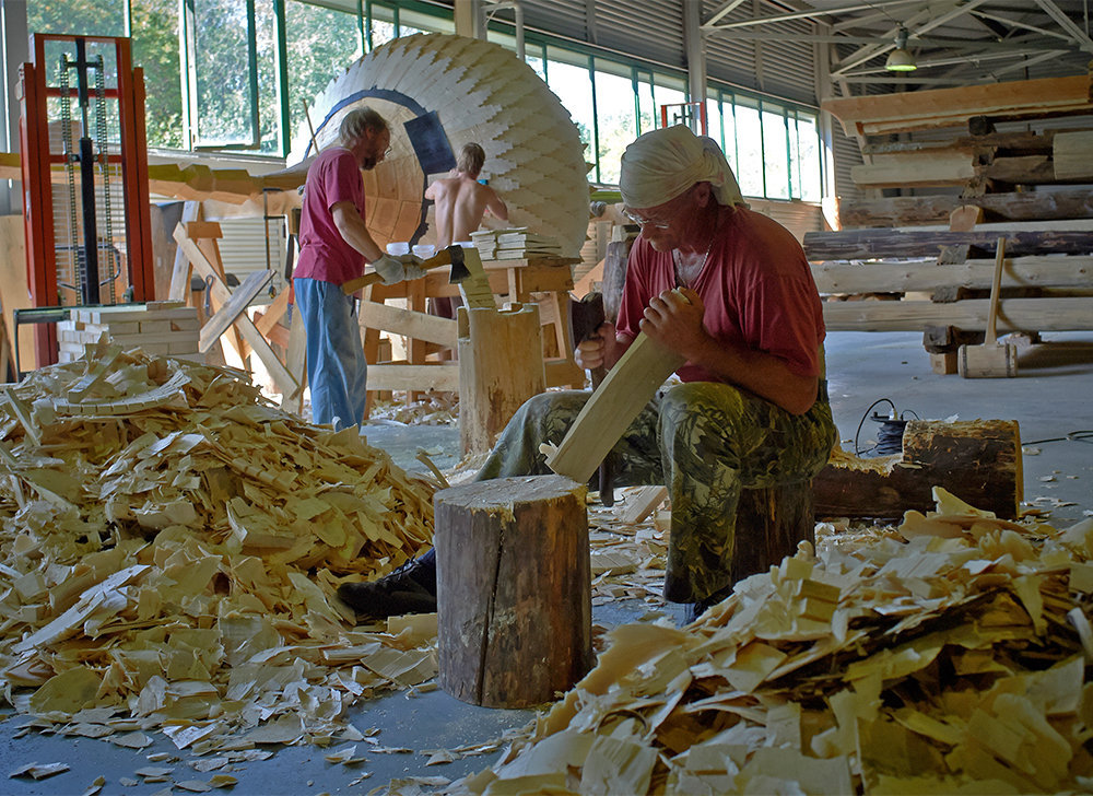 Restoration workers making aspen lemekhs (shingles for roofing) for the domes of the Church of the Transfiguration of Our Lord