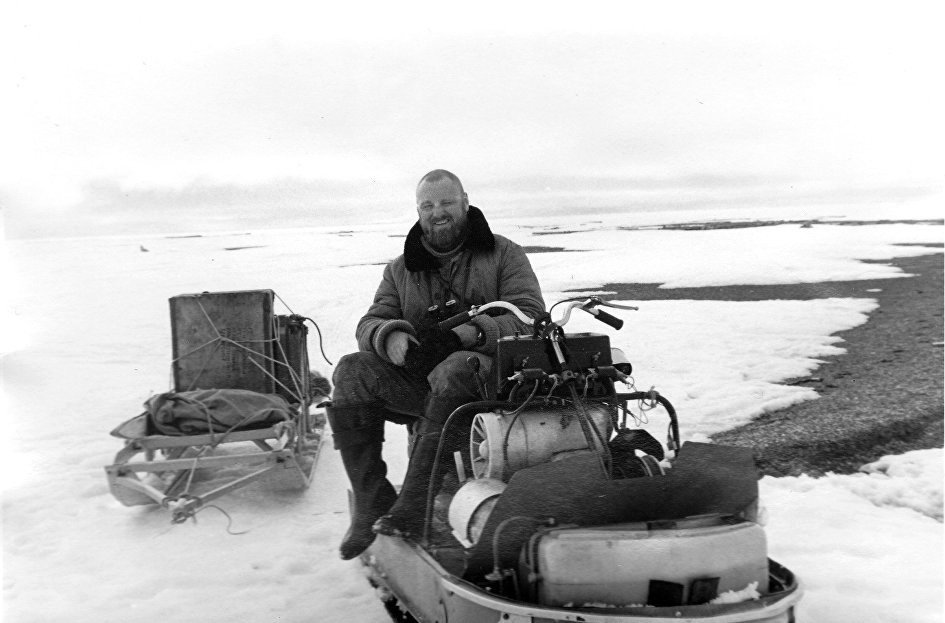 Nikita Ovsyannikov riding a snowmobile to Vrangel Island, spring, 1993