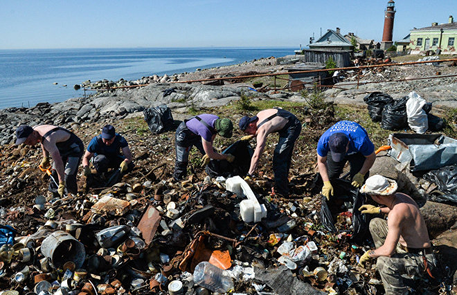 Volunteers undertake massive clean-up job on a deserted Arctic island