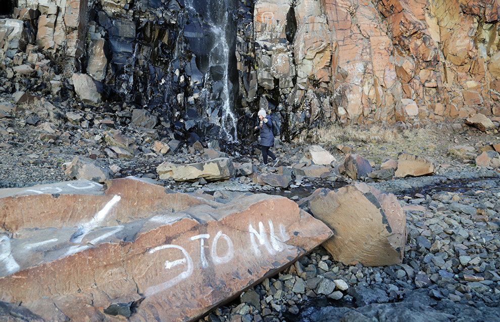Activists tried to clean graffiti off the cliffs, but didn't have enough time to finish this during the warm season. They plan to continue next year