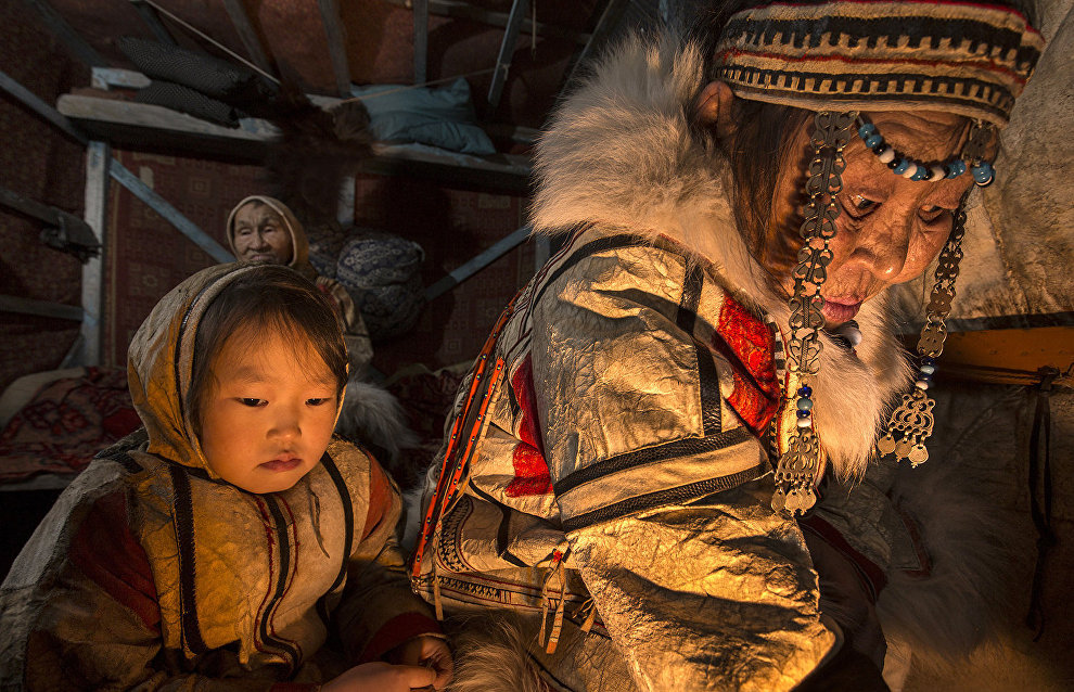 A Nganasan woman and her granddaughter light a fire. Khatanga, Taimyr