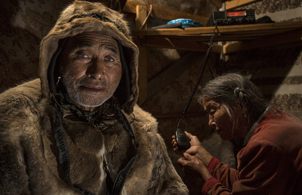 Dolgan reindeer herders communicate with their nomad neighbors via a shortwave radio. The valley of the Popigai River, Taimyr