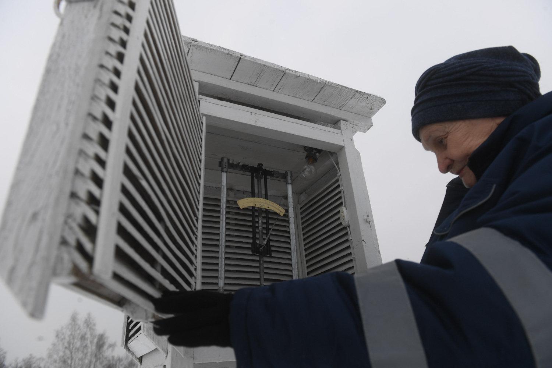 Nina Kopylova, head of the weather station, logs instrument readings, Dmitrov