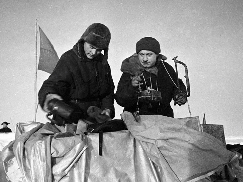 Ivan Papanin (right) and Pyotr Shirshov [left] pack kitchen utensils during evacuation of SP-1 polar station