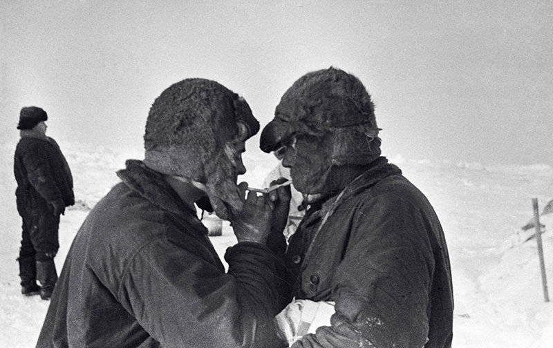 Ernst Krenkel (left) and Peter Shirshov (right) smoking on the ice floe after having spent there so many anxious days and nights