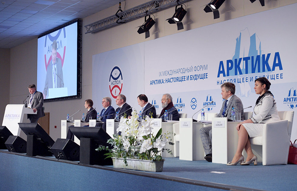 Vice-Governor of St. Petersburg Eduard Batanov, left, speaks at the plenary meeting, Regions as Participants in the Development of the Russian Arctic Zone, held as part of the 9th International Forum The Arctic: Today and the Future, in St. Petersburg