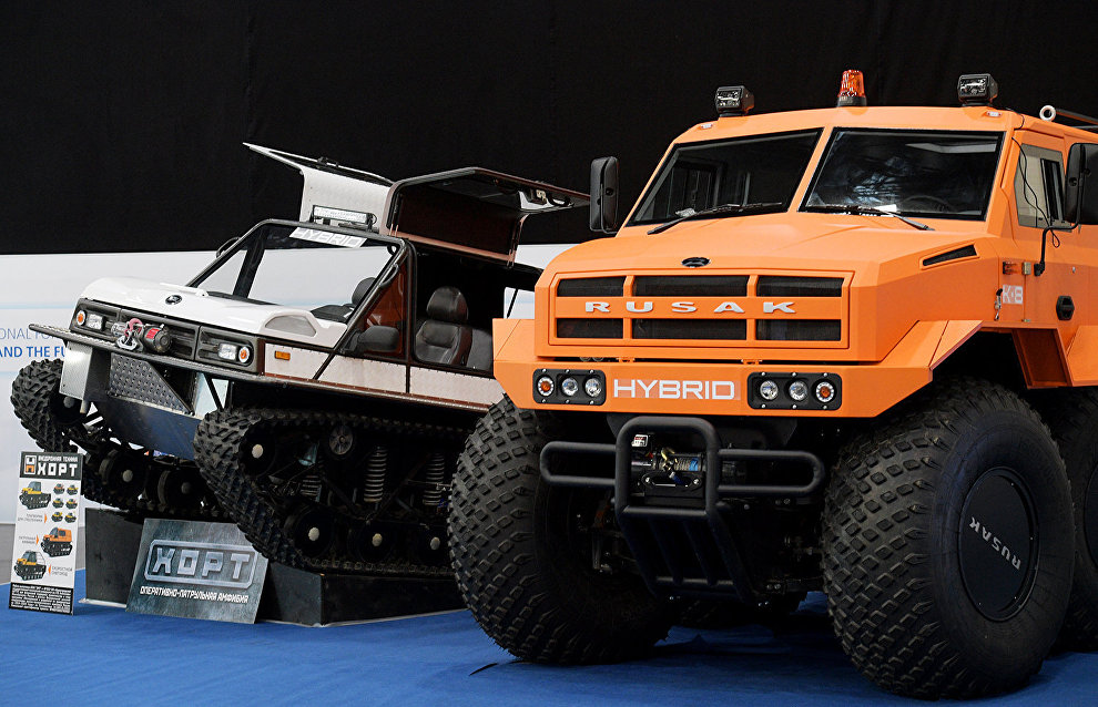 The Russian-made Hort-3918 ATV, left, and the Rusak Zёma 8x8 ATV displayed at the 9th International Forum The Arctic: Today and the Future, in St. Petersburg
