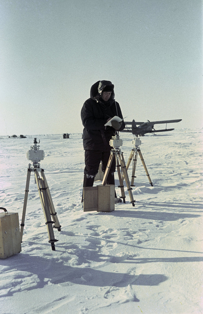 The Soviet North Pole 8 drifting research station. A researcher is taking readings