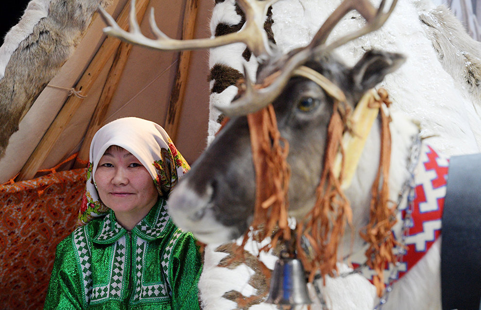 A representative of the indigenous peoples of the Yamal-Nenets Autonomous Area at the region's stand during the 9th International Forum The Arctic: Today and the Future, in St. Petersburg