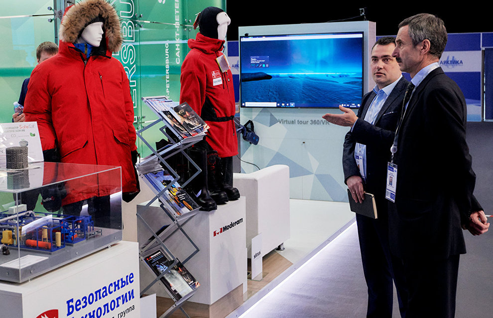 Forum participants at the stands of the companies Safe Technologies Industrial Group, left, and Moderam during the 9th International Forum The Arctic: Today and the Future, in St. Petersburg