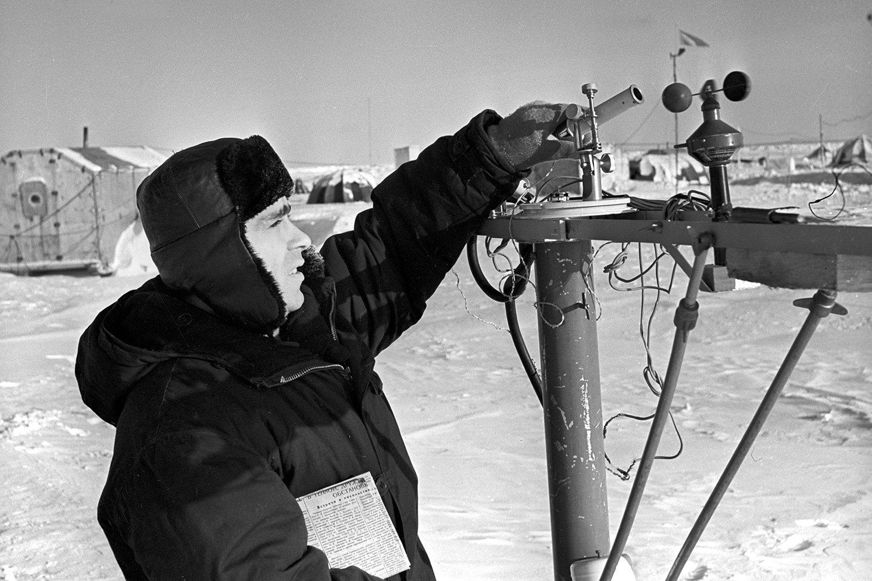 Meteorologist-aktinometrist Nikolai S. Makarov taking readings at the drifting ice station North Pole-12