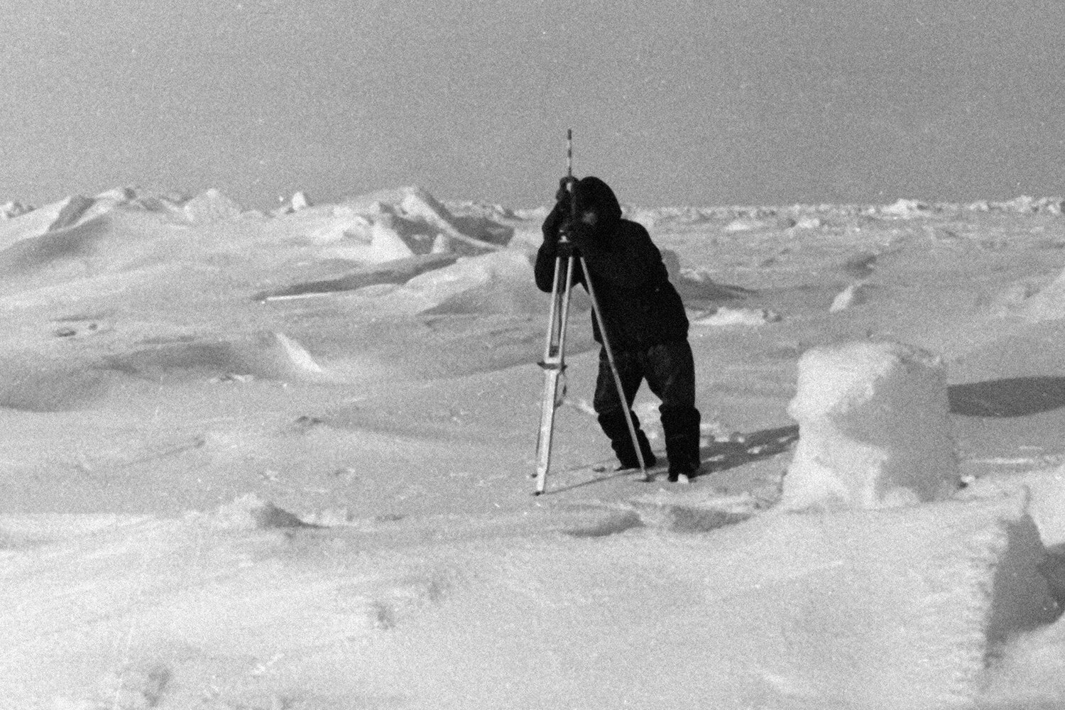A magnetologist of the North Pole-12 station in the Arctic taking bearings of the station
