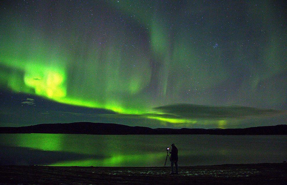 Northern lights over the Ura River, Murmansk Region