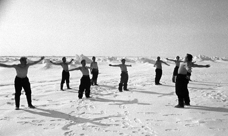 Polar explorers doing morning exercises