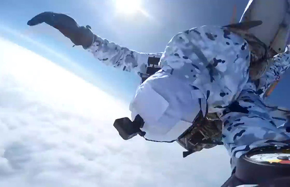 Russian paratroopers perform a group jump from an Ilyushin Il-76 aircraft from 10,000 m of altitude, using parachute systems in the extreme Arctic conditions near the Franz Josef Land Archipelago