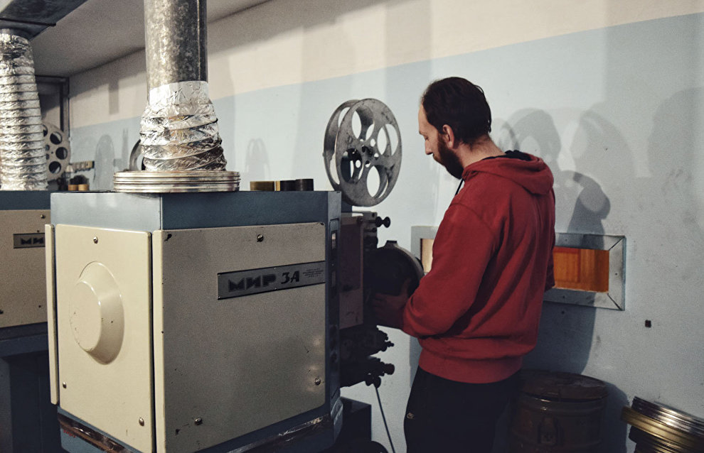 Stanislav Schubert works with Mir movie projectors