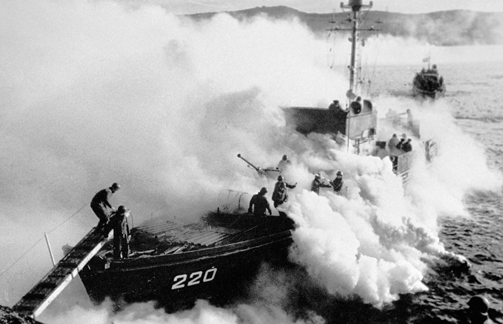 Ships hiding behind a smoke-screen after the landing operation