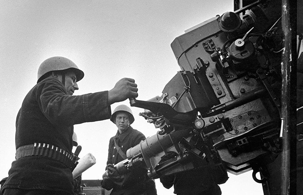 Soviet Northern Fleet AA gunners firing at the enemy