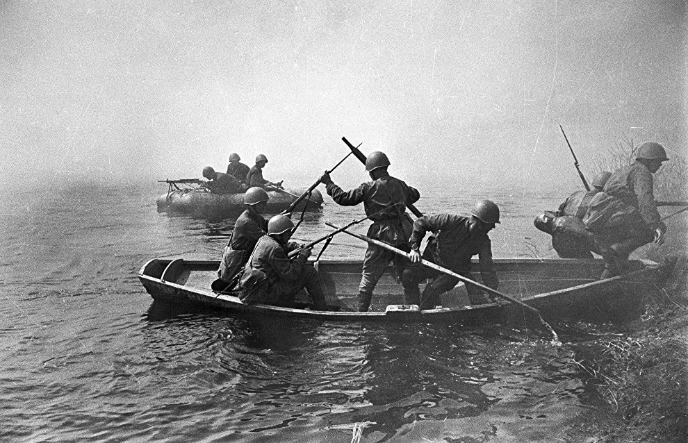Soldiers crossing a river. The North-Western Front