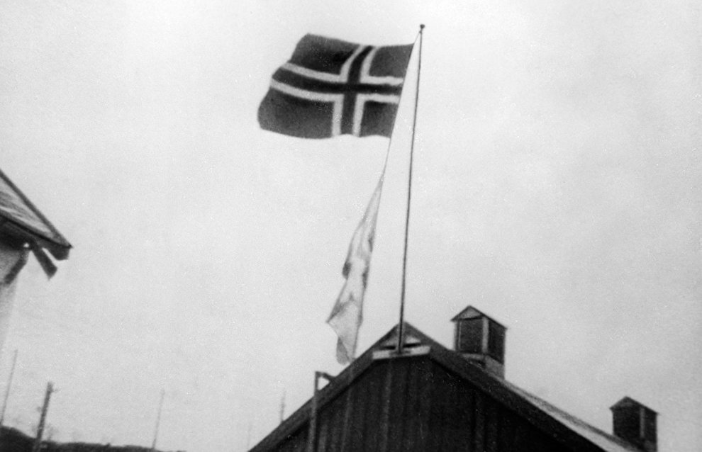 The national flag of Norway hoisted on a house roof in liberated Kirkenes