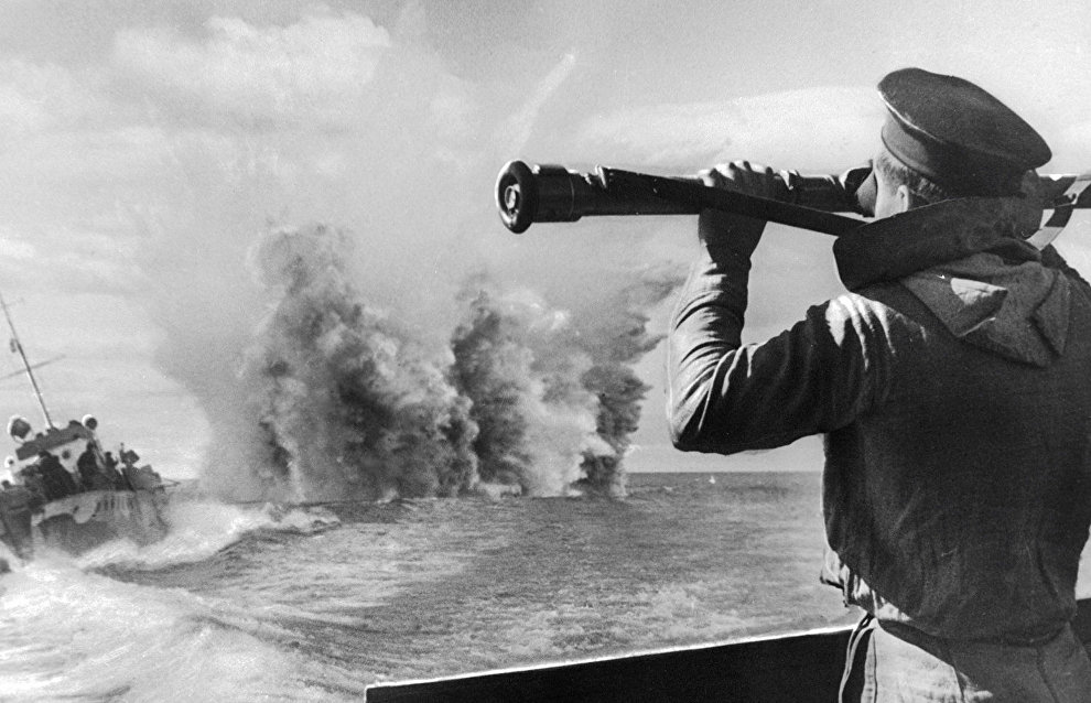 A sailor observing the results of depth bombing of submarines