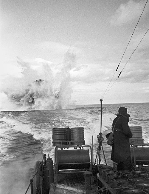 The Great Patriotic War of 1941-45.The Northern Fleet. A Soviet motorship bombs a detected German submarine, 1944